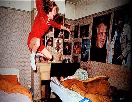 A still image of the real Janet Hodgson being levitated from her bed
