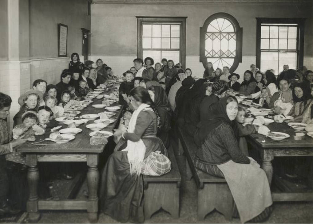 Immigrants being served a free meal at the hospital