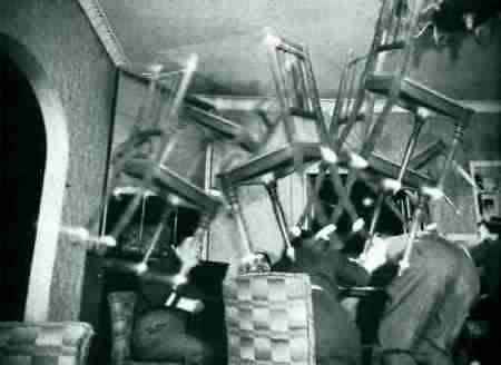 A still image from chairs being thrown at people
