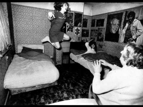 An iconic photo of Janet being levitated from her bed