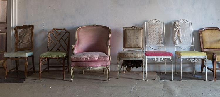 Mismatched chairs from various rooms sit together in abandonment