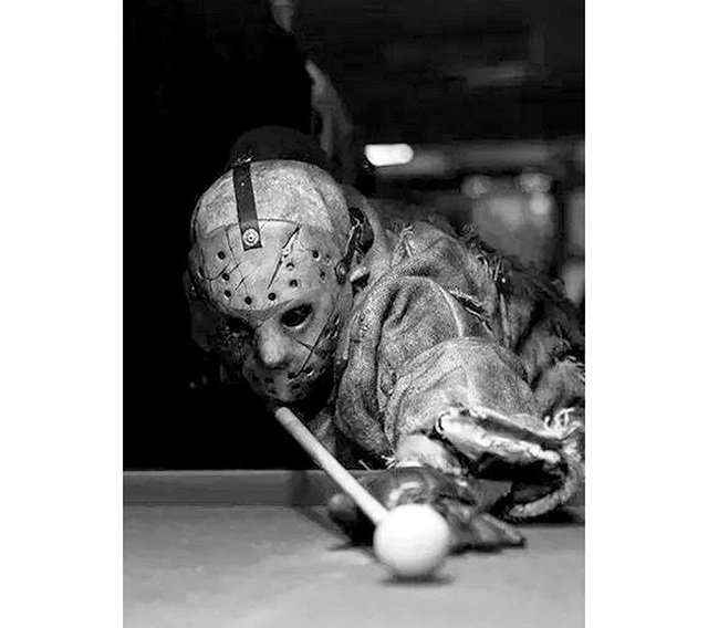 Jason playing billiard